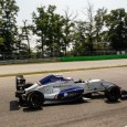 Jake Hughes survived a chaotic second race of Formula Renault 2.0 Alps' Monza round to take his second win and emerge as the points leader.