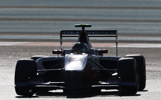 Marvin Kirchhofer scored his fifth victory of the season in the main GP3 race at Yas Marina after Esteban Ocon was penalised, keeping the title race wide open with a race to go.